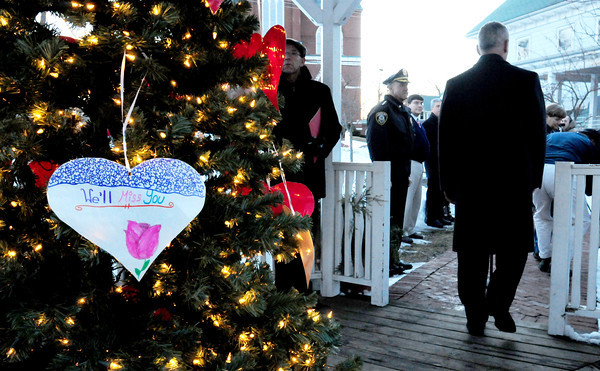 Amesbury: Amesbury Mayor Thatcher Kezer is the last to put a Valentine on a Christmas tree in the town gazebo honoring the victims of the Newtown, Conn. mass shooting in December. Bryan Eaton/Staff Photo