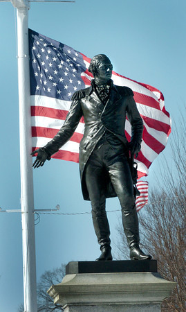 Newburport: A strong wind blows the US flag behind this statue of the country's first president, George Washington, at Bartlet Mall on President's Day. Temperatures will be warming, though periods of wind continue through the end of the week. Bryan Eaton/Staff Photo