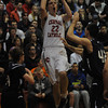 Lawrence:Central's Nick Cambrio hits a jumper during thier game against St Johns at Central Catholic Sunday night. JIm Vaiknoras/staff photo