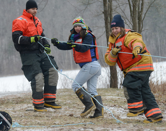 West Newbury: Colin Bryant, Kaleena Percival, and Kara Percival participate  in a ice rescue drill on Mill Pond Sunday. The exercise was part of the Mill Pond Winter Carnival. Jim Vaiknoras/staff photo