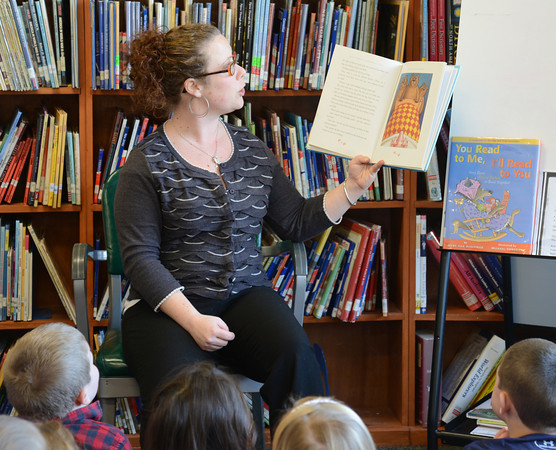 "Newburyport: Bresnahan School librarian Sarah Menesale reads "" Goldie Pig and the Three Bears"" to 2nd graders in John Gangemi class. The class is working on Fractired Fairy Tales combining stories and mixing up old stories to come up with new takes on old tails. Jim Vaiknoras/staff photo"