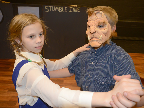 Salisbury: Abigail Davis as Belle dances with her brother Andrew Davis as the Beast in a rehearsal for the Boy and Girls Club production of Beauty and the Beast. Performances are Friday at 6:30, and Saturday at 1 and 6:30 at the Boys and Girs Club in Salisbury. Jim Vaiknoras/staff photo
