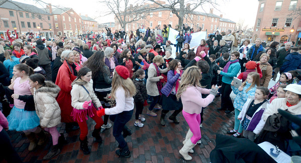 Newburyport: Hundreds turned out to dance and watch a Flash Mob in Market Square as part of the international nonprofit organization One Billion Rising. whose mission is violence prevention Events like this were held around the world. Jim Vaiknoras/staff photo