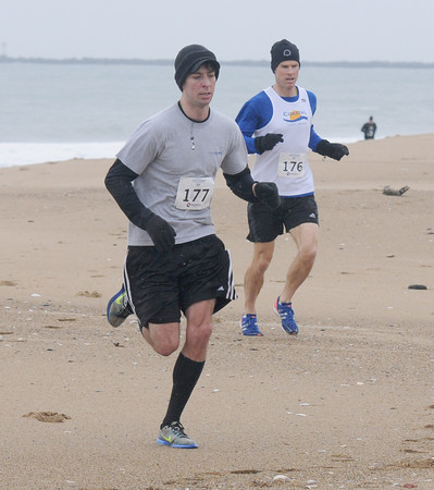 Salisbury: Winner Brent Trail edges out 2nd place finisher Timothy Carven in the Frosty Knuckle 5k race at Salisbury Beach Saturday. Jim Vaiknoras/staff photo