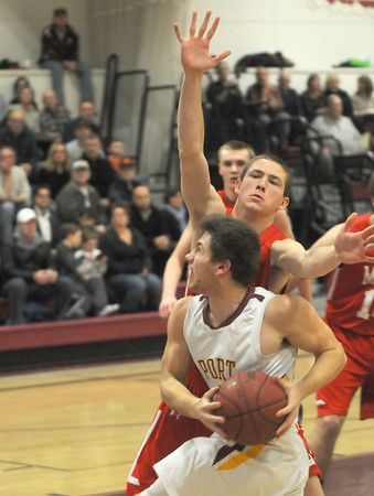 Newburyport: Newburyport's Colton Fontaine drives to the basket during the Clippers game against Masco at Newburyport high Friday night. Jim Vaiknoras/staff photo