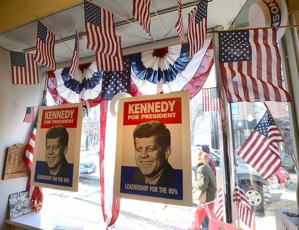 Amesbury: Campaign posters fill the window at John McInnis in Amesbury Thursday previewing the JFK auction . The auction which has gain national attention is Sunday. Jim Vaiknoras/staff photo