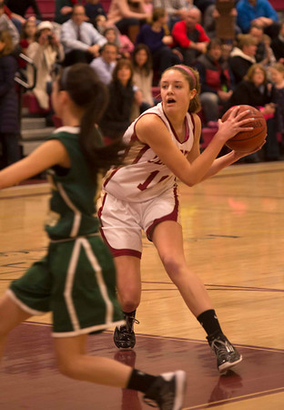 Newburyport: Newburyport's Emily Pettigrew makes a move against North Reading during their game at Newburyport Friday night. Jim Vaiknoras/staff photo