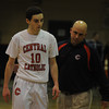"""Lawrence:Central coach Rick Nault concoles Lucas Hammel after their loss to St John""""s  at Central Catholic Sunday night. JIm Vaiknoras/staff photo"""