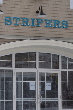 Salisbury: Closed signs on the doors of Stripers in Salisbury. Jim Vaiknoras/staff photo