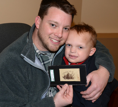 Newburyport: Jason Leblanc hold his son Alex and the original baseball card he recently purchased at auction. JIm Vaiknoras/staff photo
