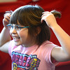 Newburyport: Nieve Morrissey, a 2nd grader in John Gangemi class at the Bresnahan School in Newburyport, minics the ears of the Big Bad Wolf with her hair at the school library Monday. her class is working on Fractired Fairy Tales combining stories and mixing up old stories to come up with new takes on old tails. Jim Vaiknoras/staff photo
