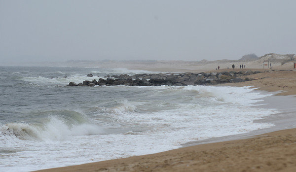 newbury: A few brave souls walk along Plum Island Beach on a cold windy winter morning Sunday. Jim Vaiknoras/staff photo