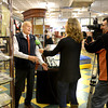 Amesbury: Julia Vassey and Michael Slymam of  Russian Television interview Charlie Hamilton at a preview of the JFK auction at John McInnis in Amesbury Thursday. The auction which has gain national attention is Sunday. Jim Vaiknoras/staff photo
