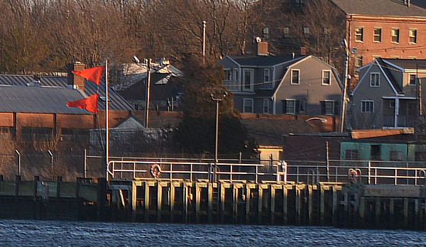 newburyport: Two red flags fly at the Coast Guard Station in Newburyport Thursday afternoon indicating a  Gale Warning (Winds between 39-54 MPH). Jim Vaiknoras/staff photo
