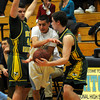 Byfield: Triton's Zakariya Alaoui gets fouled by 2 North Reading players during their game at Triton Thursday night. Jim Vaiknoras/staff photo