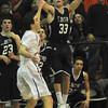 Lawrence:  St John's  Drex Costello watches as his game winning  3 pointer goes in at Central Catholic Sunday night. JIm Vaiknoras/staff photo