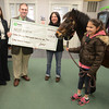 Groveland:Retail Manager  Charlene Ricci and Branch Manager Justin Otto present Mary Martin of New England Equine Rescue North with a donation of $3395.36 at the Groveland TD Bank. Helping her out are Isobell Bounsy and Boo.Jim Vaiknoras/staff photo