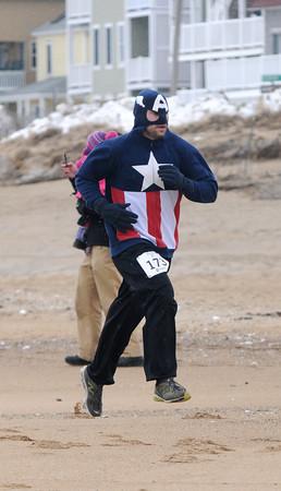 Salisbury: Michael Uttley of Newburyport dressed in a Capt. America sweatshirt to run the Frosty Knuckle 5k in Salisbury Saturday. Jim Vaiknoras/staff photo