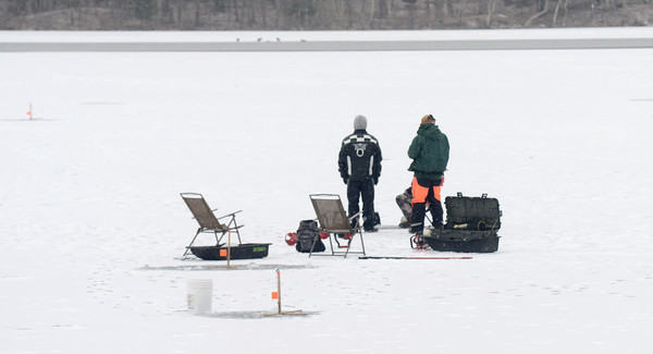 Newburyport: Two ice fishermen wait for a a hit on their traps on the Artichoke in Newburyport Sunday. The ice fishing derby that was planned for this past weekend has been move to next Sunday on the Reservoir. Jim Vaiknoras/staff photo