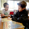 Newburyport: Brendan Robinson and his writing partner Tarek El Ouilani, both 2nd graders in John Gangemi class at the Bresnahan School in Newburyport, work on their Fractured Fairy Tale at the school library Monday. Their story involves a combination of Chicket Little, Big Foot and Cinderella. Jim Vaiknoras/staff photo