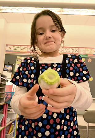 "Salisbury: Gracie Campbell, a second grader in Kelly Clayton class, shows off a pisanki, a Polish Easter Egg, during her presentation about Poland at ""Passport to Learning"" at  the Salisbury Elementary School Friday. Jim Vaiknoras/staff photo"