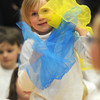 newburyport: Kindergatener Zoe Moccia of Amesbury juggles scarves during the River Valley Charter School Circus at the school Friday. Each student was taught a set of circus skills , like plate spinning, diablol sticks and juggling which they performed at the show. JIm Vaiknoras/staff photo