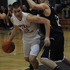 Lawrence:Central's Lucas Hammel drives to the basket during thier game against St Johns at Central Catholic Sunday night. JIm Vaiknoras/staff photo