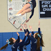 Byfield: The Triton cheerleaders get ready to catch fellow cheerleader Caitlin Clark during their performance at the Cape Ann Championships at Triton Sunday. Jim Vaiknoras/staff photo