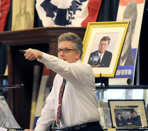 Amesbury: Dan Meader point to a bidder  at the JFK auction at the John McInnis Auction house in Amesbury Sunday. Jim Vaiknoras/staff photo