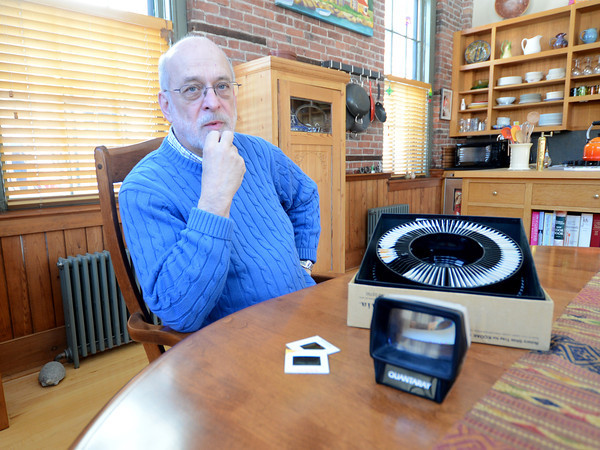 Newburyport: Bob Loiselle with slides he bought at a yard sale and is trying to find who shot them. Jim Vaiknoras/staff photo