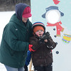 West Newbury: Jennifer Close helps her son Morgan keep his balance on the ice as he puts on his gloves at the Mill Pond Winter Carnival Sunday in West Newbury. Jim Vaiknoras/staff photo