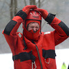 West Newbury: West Newbury Deputy Fire Chief Mark Hemingway has a bit of trouble putting on a helmet before participating in a ice rescue drill on Mill Pond Sunday. The exercise was part of the Mill Pond Winter Carnival. Jim Vaiknoras/staff photo