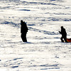 Amesbury: A trio of sledders makes their way up the hill at Woodsom Farm Sunday morning. Jim Vaiknoras/staff photo