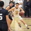 newburyport: Newburyport's Ian Michaels drives to the basket against Hamilton-Wenham at Newburyport high. Jim Vaiknoras/staff photo