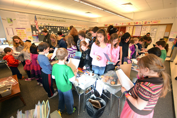 "Salisbury:Parents and students crowd into Michelle Howards 2nd grade class for the annual ""Passport to Learning"" at  the Salisbury Elementary School Friday. Students wrote essays on countries of their family origins and gave presentations using objects from those countries. Jim Vaiknoras/staff photo"