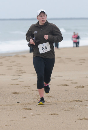 Salisbury: Woman's winner Kristen Merlo in the Frosty Knuckle 5k race at Salisbury Beach Saturday. Jim Vaiknoras/staff photo