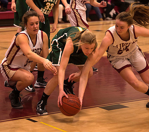 Newburyport: Newburyport's Mary Pettigrew and Lilly Donovan dive for a loose ball with North Reading's Elise Makowski during their game at Newburyport Friday night. Jim Vaiknoras/staff photo