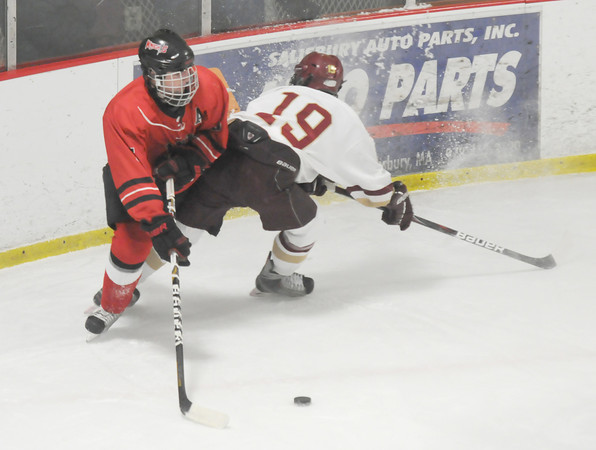 newburyport: Newburyport's Nicholas Federico  checks North Andover's Daniel Rivet during their game at the Graf Rink last night. Jim Vaiknoras/staff photo
