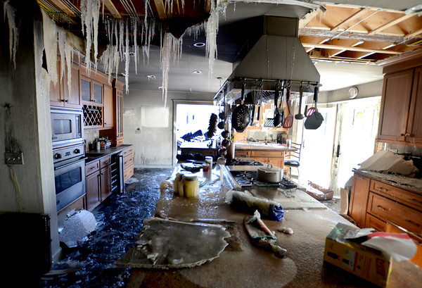 West Newbury: Icicles hang down in the kitchen at 11 River Road in West Newbury after a fire destroyed the home Friday night. JIm Vaiknoras/staff photo