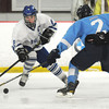 Newburyport: Triton's Derek Donley knocks the puck away from Danvers player JKevin Hodgkins during their game at the Graf Rink Friday. Jim Vaiknoras/staff photo