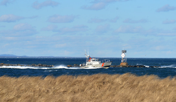 Newbury: The Coast Guard 44 footer heads out in choppy water towards the mouth of the Merrimack River off Plum Island. Jim Vaiknoras/staff photo