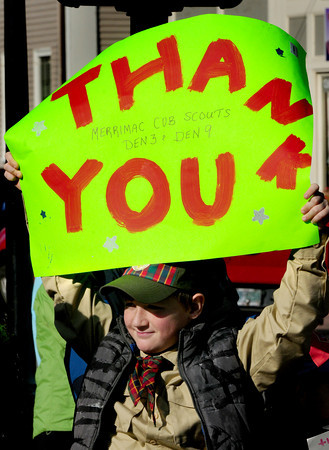 Newburyport: Merrimac webelo Jesse Judson, 9, holds a sign thanking veteran's at Newburyport's Veteran's Day ceremonies. Bryan Eaton/Staff Photo