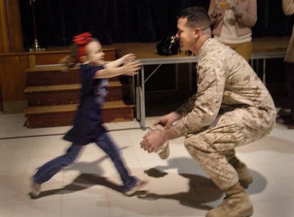 Rowley: Isabelle McCann is just a blur as she runs to her father Steve who just returned from a tour in Afghanistan and surprised her at the Pine Grove School in Rowley yesterday afternoon. Bryan Eaton/Staff Photo<br /> , Rowley: Isabelle McCann is just a blur as she runs to her father Steve who just returned from a tour in Afghanistan and surprised her at the Pine Grove School in Rowley yesterday afternoon. Bryan Eaton/Staff Photo