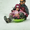 Newburyport: Callie Pare, 6, of Newburyport and her mother Stacey get in some sledding at March's Hill in Newburyport yesterday afternoon. The snow that fell should stay around awhile as the temperatures are to get colder this week. Bryan Eaton/Staff Photo