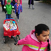Newburyport: Priya Kaur, 5, leads the way of her kindergarten class of the Brown School in Newburyport to the Salvation Army. The children collected 114 items for Thanksgiving and delivered them in three wagons. Bryan Eaton/Staff Photo