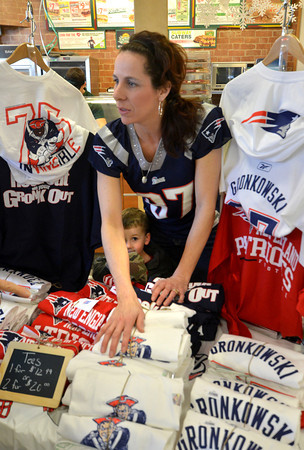 Seabrook: Tania Manning of Georgetown gets some help from her son Trevor, 3,  as she sells t-shirts at the Seabrook One Stop Friday. The store held a promotion for the Patriots lottery ticket, which included a visit from two Patriot cheerleaders. Jim Vaiknoras/staff photo