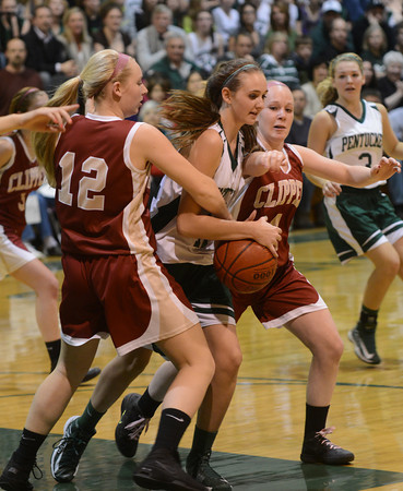 West Newbury: Pentucket's Riley Holden has the ball knocked away by  Newburyport's Morgan Johnson and Amy Sullivan during their game at Pentucket Friday night. Jim vaiknoras/staff photo