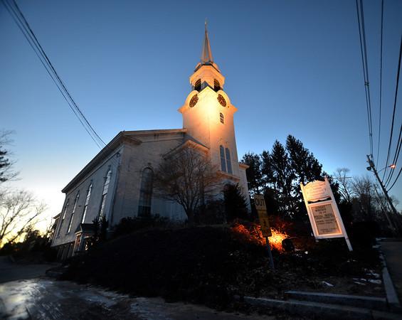 Newbury: The sun sets behind the First Parish Church of Newbury on a cold Sunday night. Jim Vaiknoras/staff photo