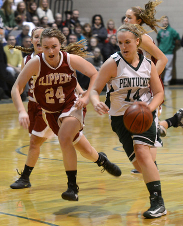 West Newbury: Pentucket's Nicole Viselli out races Newburyport's Lilly Donovan to the basket during their game at Pentucket Friday night. Jim vaiknoras/staff photo