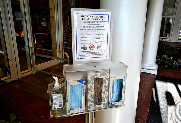 Newburyport: Visitors to the Anna Jaques hospital are greeted with a display of hand sanitizer, tissues, and surgical masks to help stop the spread of the flu. Jim Vaiknoras/staff photo